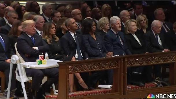 trump at bush funeral.png