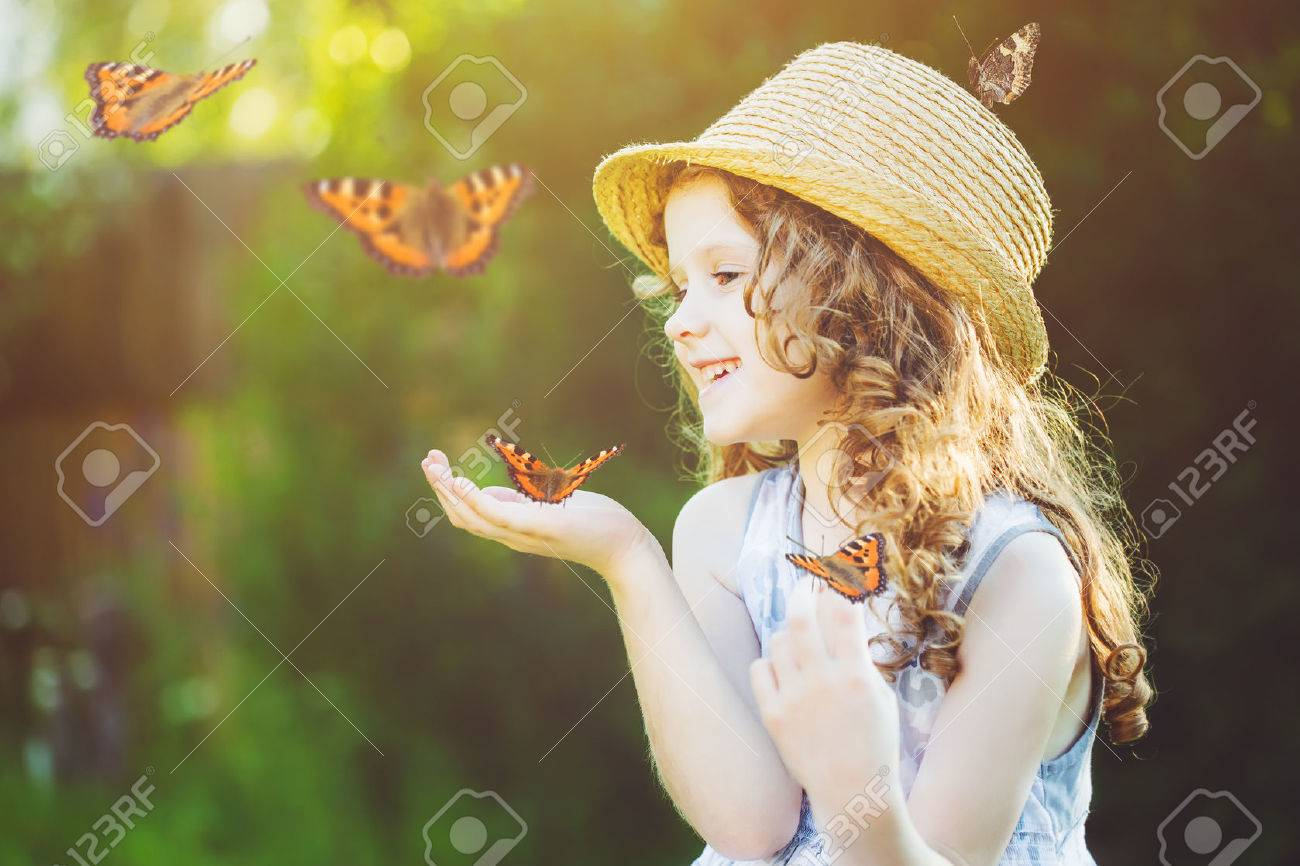42506196-laughing-little-girl-with-a-butterfly-on-his-hand-happy-childhood-concept-.jpg