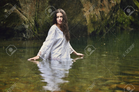 31369306-beautiful-woman-in-forest-stream-with-rain-fantasy-and-surreal-concept.jpg