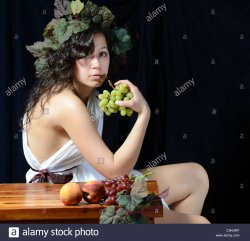 a-beautiful-women-dressed-as-dionysus-the-greek-god-of-the-grape-harvest-C0KNRP.jpg